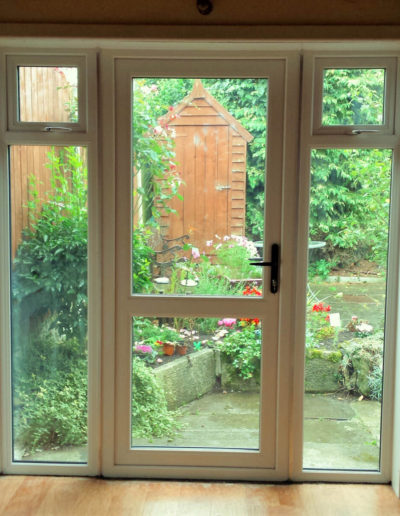 Full glass pvc door with sidelights inside view