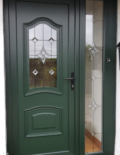 Green uPVC door with GL 1 glass design